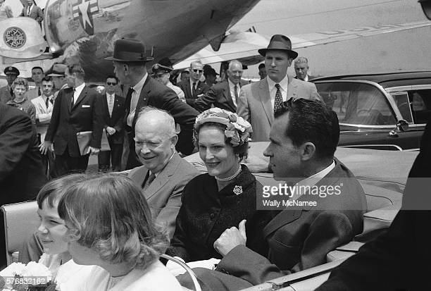 President Dwight Eisenhower sits in a convertible at Washington National Airport with Vice President Richard Nixon Nixon's wife Pat and Nixon's...