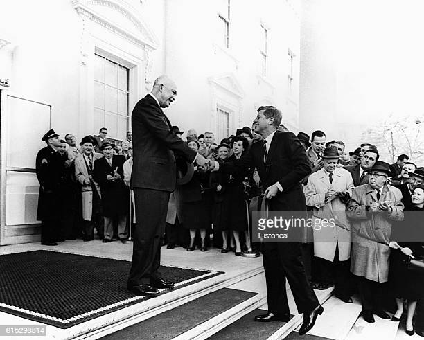 President Dwight Eisenhower welcomes Presidentelect John F Kennedy to the White House with a handshake December 6 1960