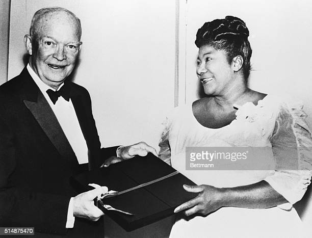 President Eisenhower accepts a gift from gospel singer Mahalia Jackson