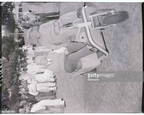 President Eisenhower and Canadian Prime Minister Louis St Laurent ride in a golf cart at the Augusta National Golf Course where the Canadian Prime...