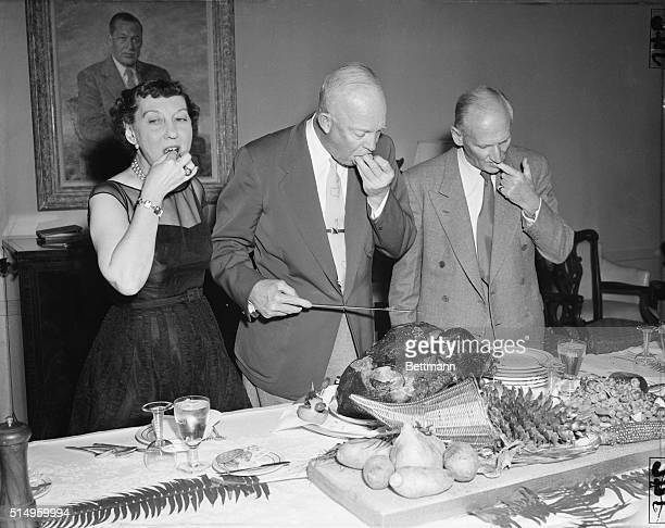 President Eisenhower does the honors as he Mrs Eisenhower and Britain's Field Marshal Viscount Montgomery sample the turkey at the Chief Executive's...