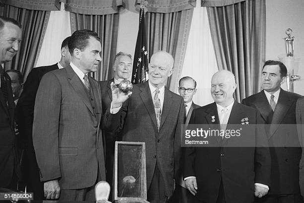 President Eisenhower holds a replica of the small sphere that landed on the moon as part of the Russian Lunik Rocket The sphere was presented to him...