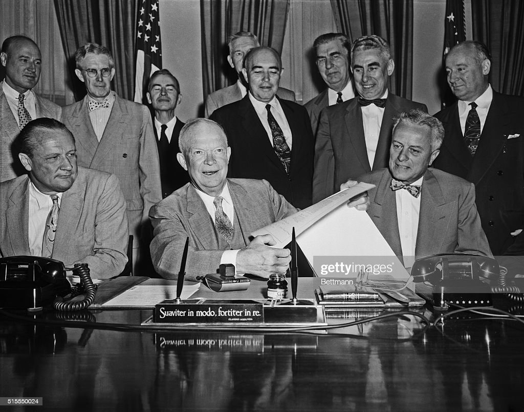 Dwight Eisenhower Surrounded by Energy Bill Participants at His Desk : News Photo