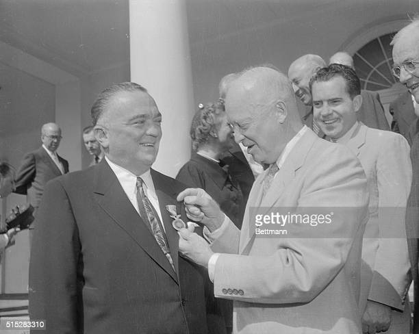 President Eisenhower is shown as he presented the National Security Medal to FBI Chief J Edgar Hoover at a White House ceremony this morning Hoover...