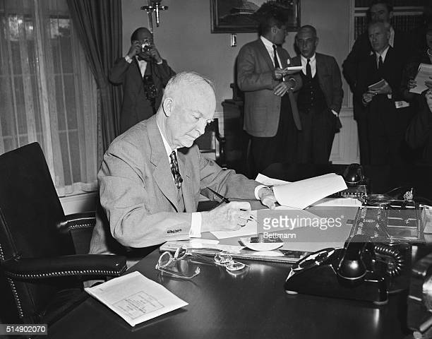 """President Eisenhower is shown signing the Middle East Resolution, popularly known as the """"Eisenhower Doctrine"""" at the White House yesterday. The..."""