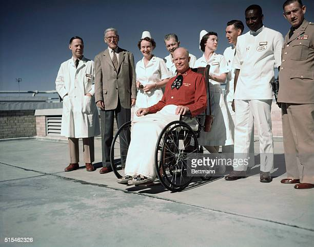 President Eisenhower poses for first pictures since he was stricken with a heart attack. He is wearing a red pajama jacket, a birthday present from...