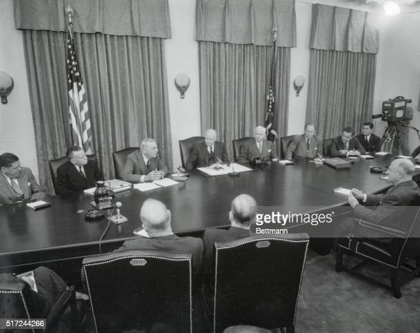 President Eisenhower presides at the first televised cabinet meeting in history October 25th during Secretary of State John Foster Dulles' report on...