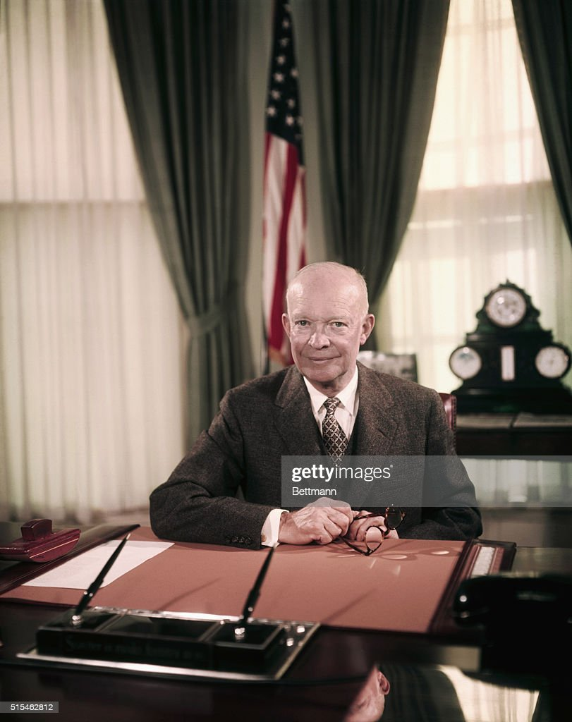 President Eisenhower Sitting at Desk in Oval Office