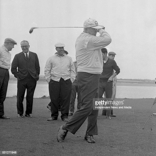 President Eisenhower Teeing off Watched by Mr McCluskey the American Ambassador Mr Freeman Goodan Mr Joe Carr R3312