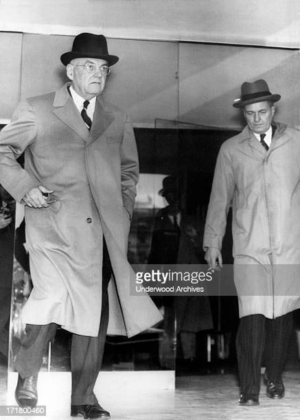 President Eisenhower's Secretary of State John Foster Dulles looks grim as he leaves after a conference with Soviet Foreign Minister VM Molotov,...