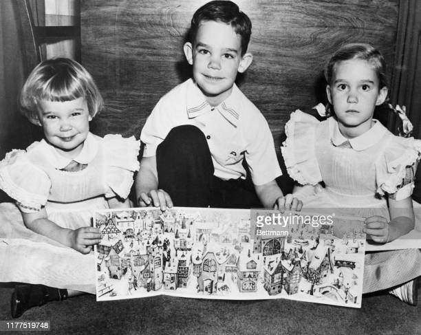 "President Eisenhower's three grandchildren join in an appeal for sales of ""Little Christmas Town"" Advent calendars by the national Epilepsy League...."