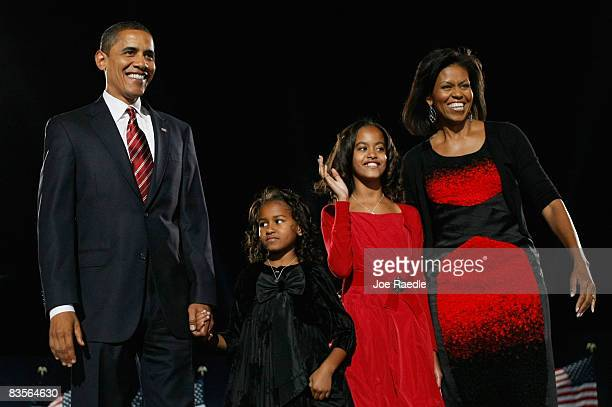 S President elect Barack Obama acknowledges his supports along with his wife Michelle and daughters Malia and Sasha to during an election night...