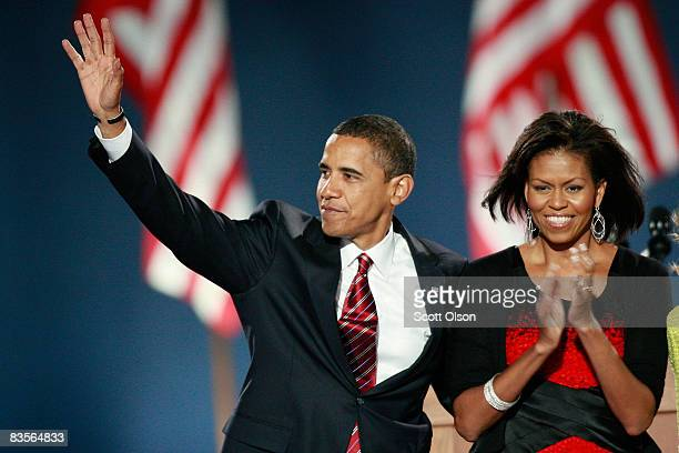 S President elect Barack Obama and his wife Michelle acknowledge their supporters after Obama gave his victory speech during an election night...