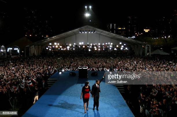 S President elect Barack Obama and his wife Michelle wave to the crowd as they walk off stage after Obama gave his victory speech during an election...