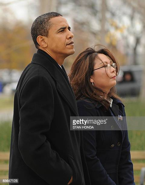 US President Elect Barack Obama and Iraqi war veteran and Illinois State Director of Veterans Affairs Tammy Duckworth pause after placing a wreath at...