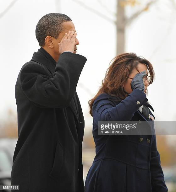 US President Elect Barack Obama and Iraqi war veteran and Illinois State Director of Veterans Affairs Tammy Duckworth salute after placing a wreath...