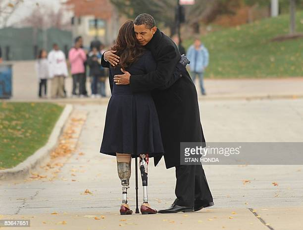 US President Elect Barack Obama embraces Iraqi war veteran and Illinois State Director of Veterans Affairs Tammy Duckworth after the two placed a...