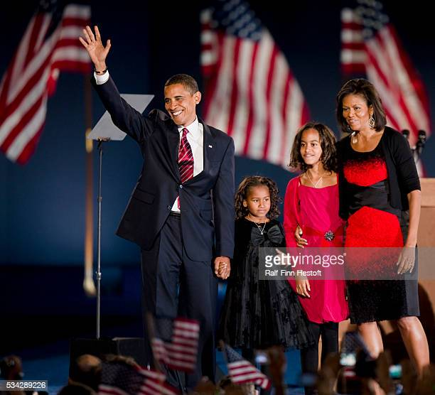 President elect Barack Obama his daughter Sasha his daughter Maila 10 and his wife Michele on the stage of his election night victory party in...