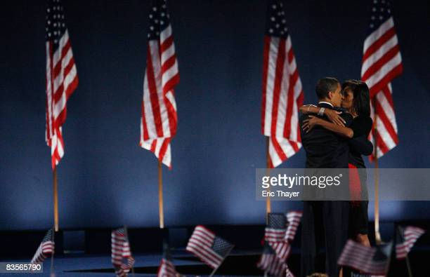 S President elect Barack Obama kisses his wife Michelle after Obama gave his victory speech during an election night gathering in Grant Park on...