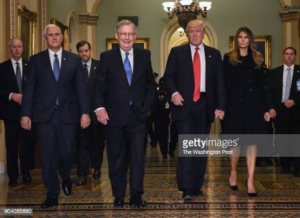President Elect Donald Trump center right walks through the halls of the US Capitol for a meeting with Senate Majority Leader Mitch McConnell center...