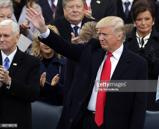 S President elect Donald Trump waves on the West Front of the US Capitol on January 20 2017 in Washington DC In today's inauguration ceremony Donald...