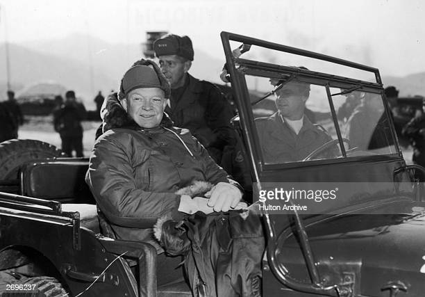 President Elect Dwight Eisenhower and General Mark Clark in a jeep during their tour of installations of the 2nd US Infantry Division on a visit to...