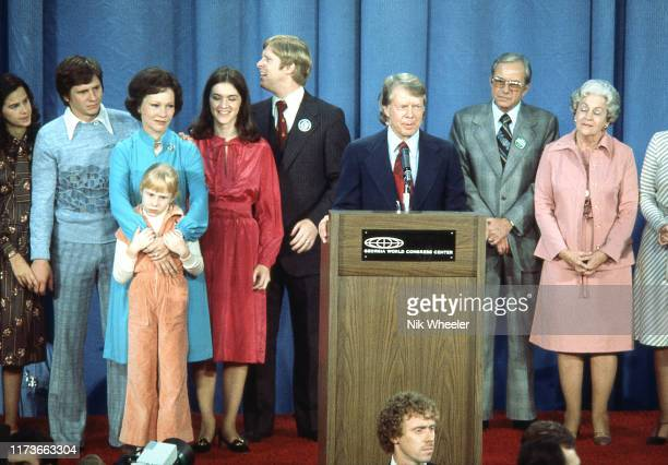 President Elect Jimmy Carter governor and peanut farmer gives victory speech with family and supporters on dais after election victory over...