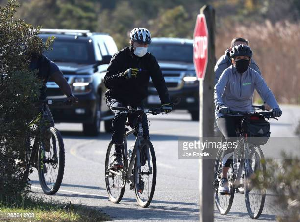 President Elect Joe Biden and his wife Dr. Jill Biden ride bicycles through Cape Henlopen State Park on November 14, 2020 in Lewes, Delaware....