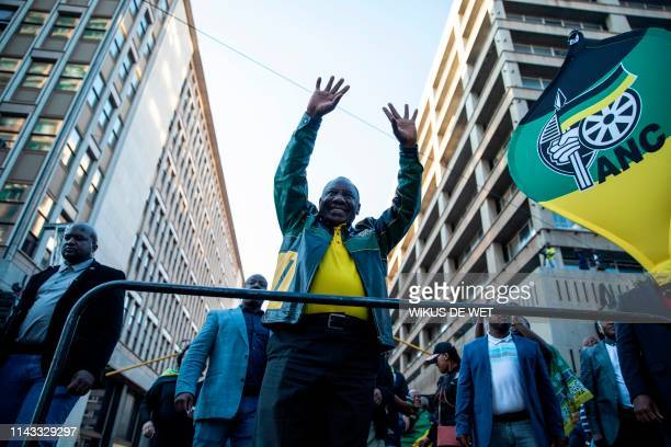 President Elect of South Africa and President of the African National Congress Cyril Ramaphosa greets the crowds after delivering a speech outside...
