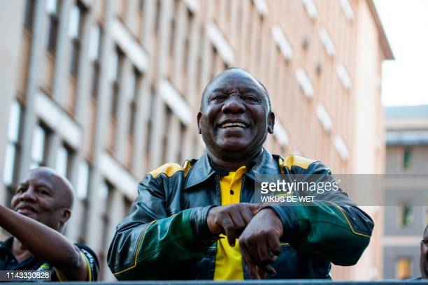 President Elect of South Africa and President of the African National Congress Cyril Ramaphosa gestures as he dances on stage after delivering a...