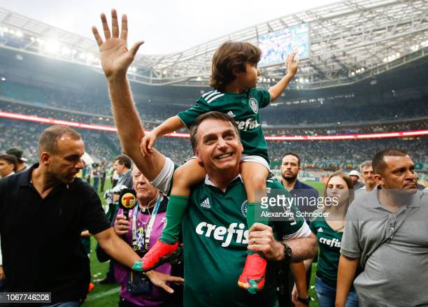 President elected Jair Bolsonaro waves the fans of Palmeiras after winning the Brasileirao 2018 after the match against Vitora at Allianz Parque...