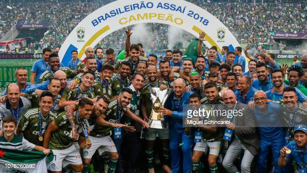 President elected of Brazil Jair Bolsonaro celebrate with players of Palmeiras after winning the Brasileirao 2018 after the match against Vitora at...