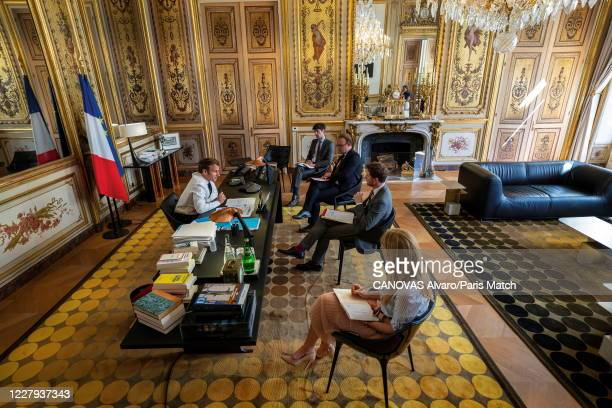 President Emmanuel Macron of France is photographed for Paris Match at his office during a conference call with Danish Prime Minister Mette...