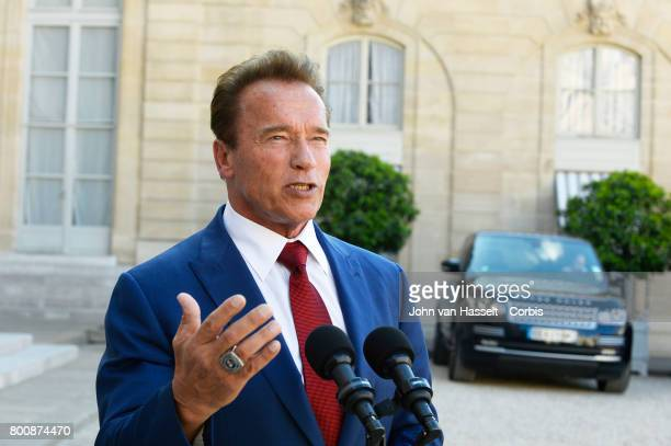 President Emmanuel Macron of France receives the former actor and governor of California Arnold Schwarzenegger on June 23 2017 in Paris France at the...