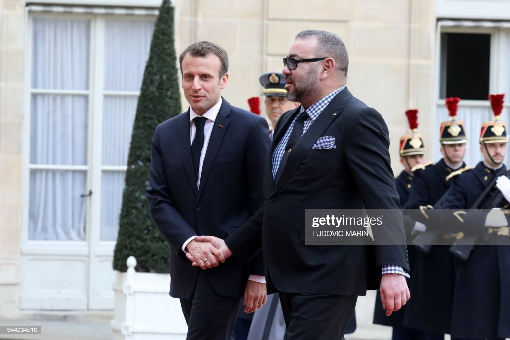 President Emmanuel Macron (L) welcomes Mohammed VI, King of Morocco, on April 10, 2018 at the Elysee Palace in Paris. /