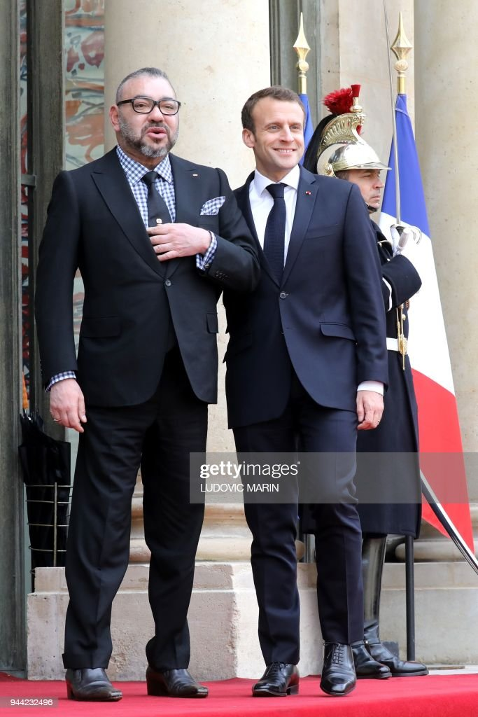 President Emmanuel Macron (R) welcomes Mohammed VI, the King of Morocco, on April 10, 2018 at the Elysee Palace in Paris. / AFP PHOTO / Ludovic MARIN / The erroneous mention[s] appearing in the metadata of this photo by Ludovic MARIN has been modified in AFP systems in the following manner: [--Mohammed VI, the King of Morocco -] instead of [--Saudi Crown Prince Mohammed bin Salman-]. Please immediately remove the erroneous mention[s] from all your online services and delete it (them) from your servers. If you have been authorized by AFP to distribute it (them) to third parties, please ensure that the same actions are carried out by them. Failure to promptly comply with these instructions will entail liability on your part for any continued or post notification usage. Therefore we thank you very much for all your attention and prompt action. We are sorry for the inconvenience this notification may cause and remain at your disposal for any further information you may require.