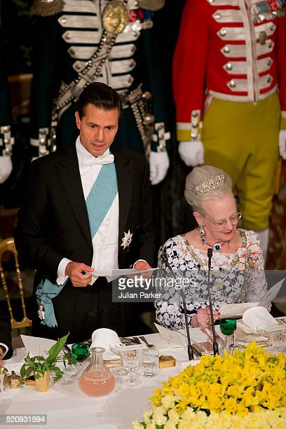 President Enrique Pena Nieto and Queen Margrethe of Denmark attend a State Banquet at Fredensborg Palace on the first day of a State visit of the...