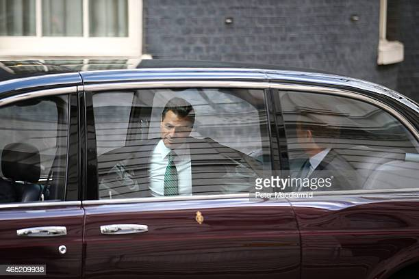 President Enrique Pena Nieto of Mexico removes his coat as he arrives in Downing Street in Queen Elizabeth II's car to meet with Prime Minister David...