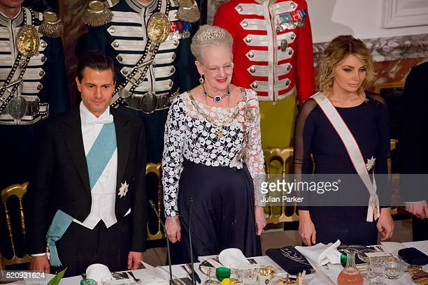 President Enrique Pena Nieto Queen Margrethe of Denmark and the Presidents wife Angelica Rivera attend a State Banquet at Fredensborg Palace on the...