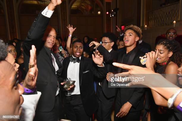 President Eric Pryon dances with students at HSA Masquerade Ball on October 23 2017 at The Plaza Hotel in New York City