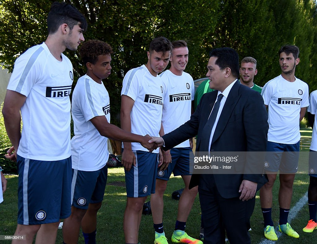 President Erick Thohir with young players during the FC Internazionale training session at the club's training ground at Appiano Gentile on August 11, 2016 in Como, Italy.