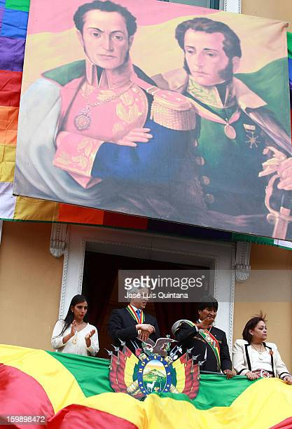 President Evo Morales and Vice President Álvaro García Linera salute from the balcony of the government palace Official to Social Organizations under...