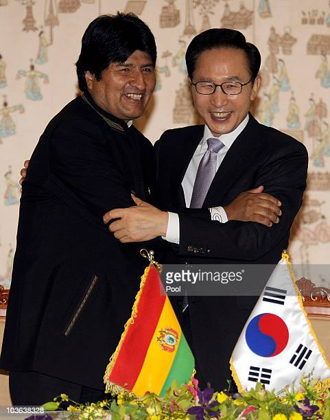 President Evo Morales embraces South Korean President Lee Myungbak during the first official visit to Korea by a Bolivian leader at Presidential...