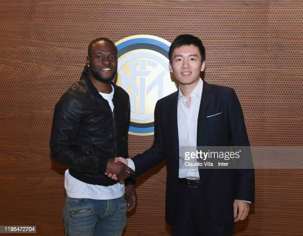 President FC Internazionale Steven Zhang Kangyang and Victor Moses of FC Internazionale pose for a photo at FC Internazionale HQ on January 21 2020...