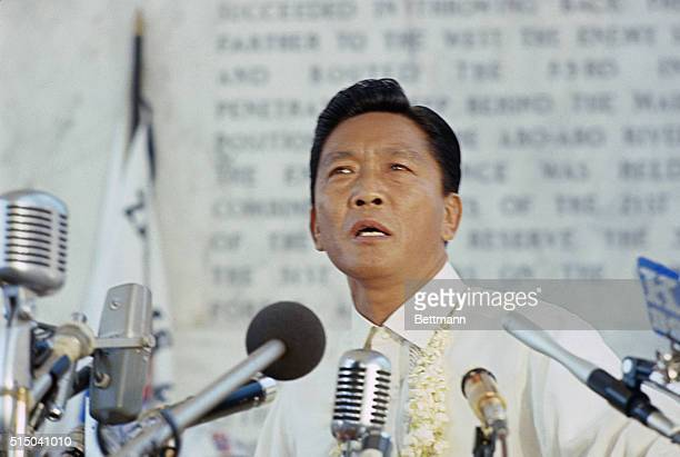 President Ferdinand E Marcos speaks at dedication of a concrete cross 92 meters high which is a war memorial on the mountain top whose fall sounded...