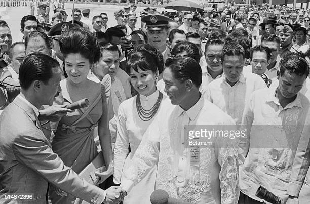 President Ferdinand Marcos and his wife Imelda greet South Vietnamese Premier Nguyen Cao Ky and his wife in Manila as they arrive for a state visit...