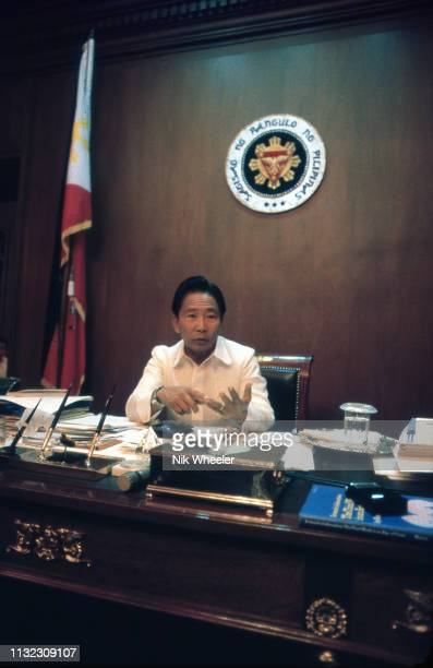 President Ferdinand Marcos of the Philippines sits at his desk in his office in Malacanang Palace in Manila circa 1986