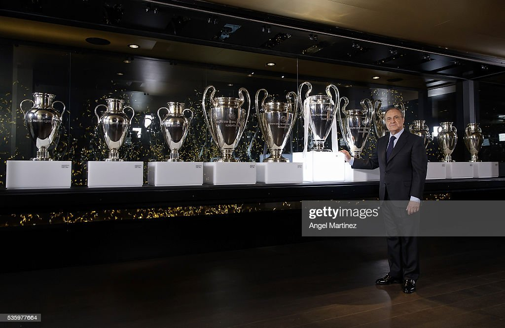 President Florentino Perez of Real Madrid places the UEFA Champions League trophy in Real Madrid museum at Estadio Santiago Bernabeu on May 31, 2016 in Madrid, Spain.