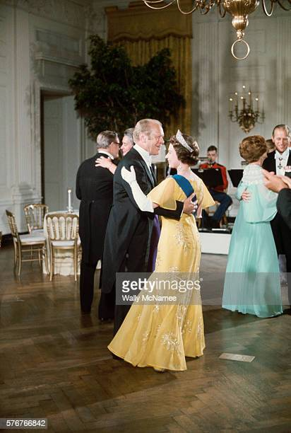 President Ford dances with Queen Elizabeth at a White House State dinner. She is being honored during her visit for her participation in the American...