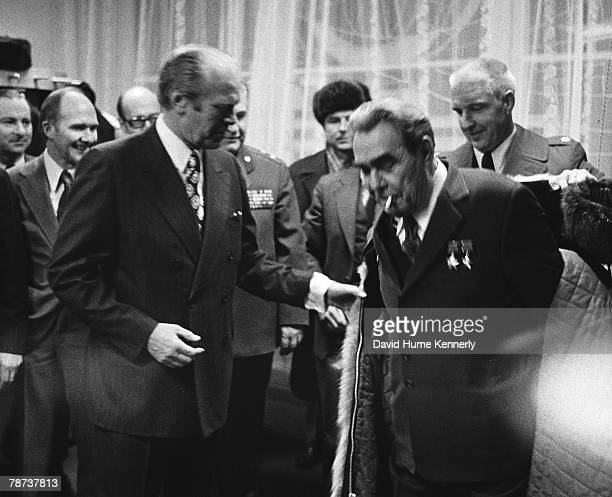 President Ford let Soviet General Leonid Brezhnev try on his fur coat Brezhnev liked it so much that in the spirit of better SovietAmerican relations...